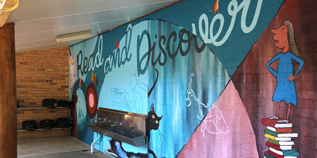 Flinders students create giant art mural with renowned public artist