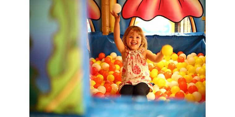 girl in ball pit at Chipmunks indoor play centre