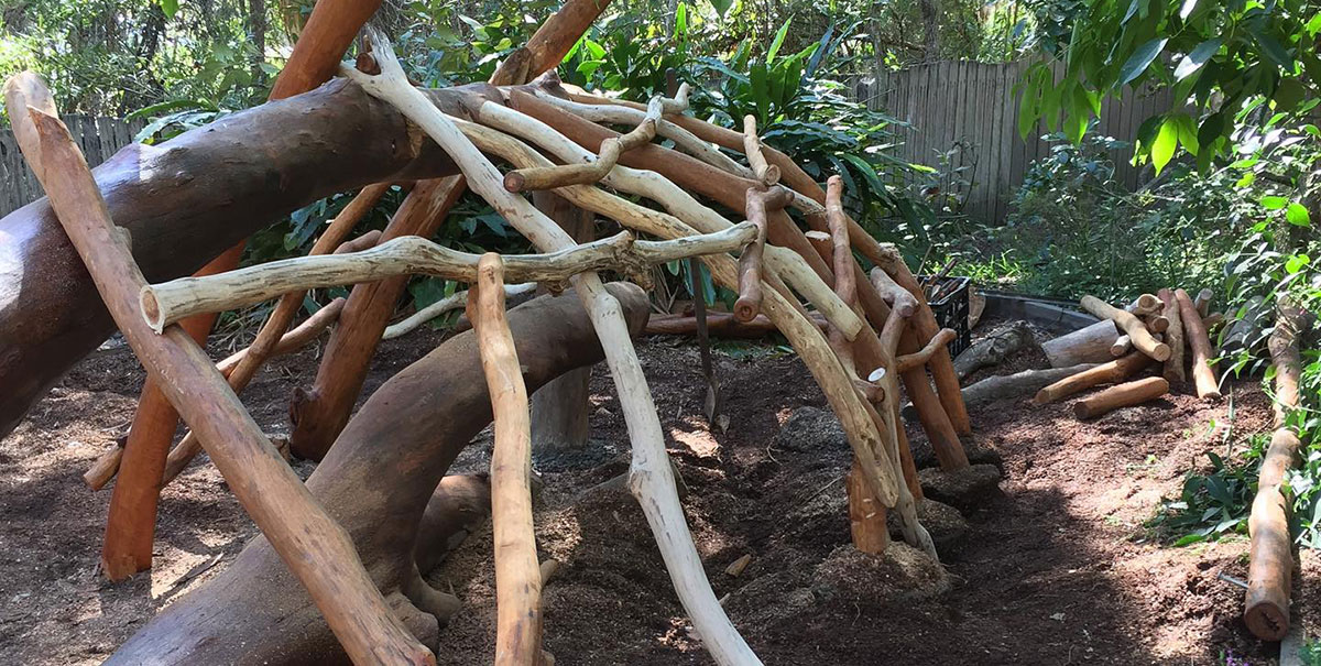 backyard cubby blended with nature play