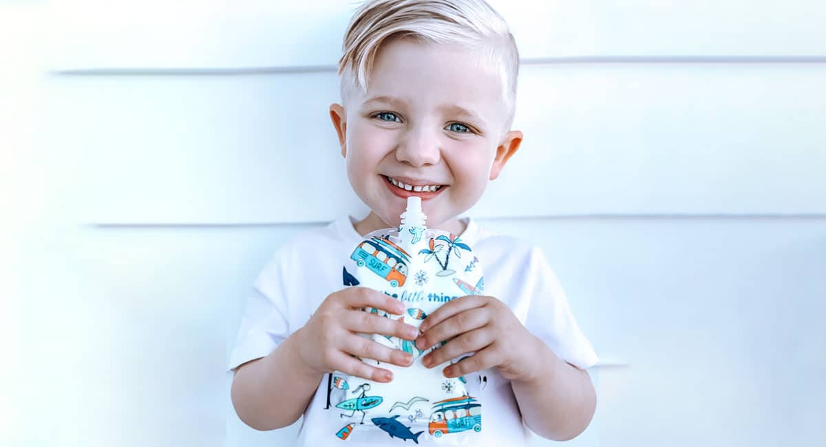 Young child with sinchies reusable food pouch