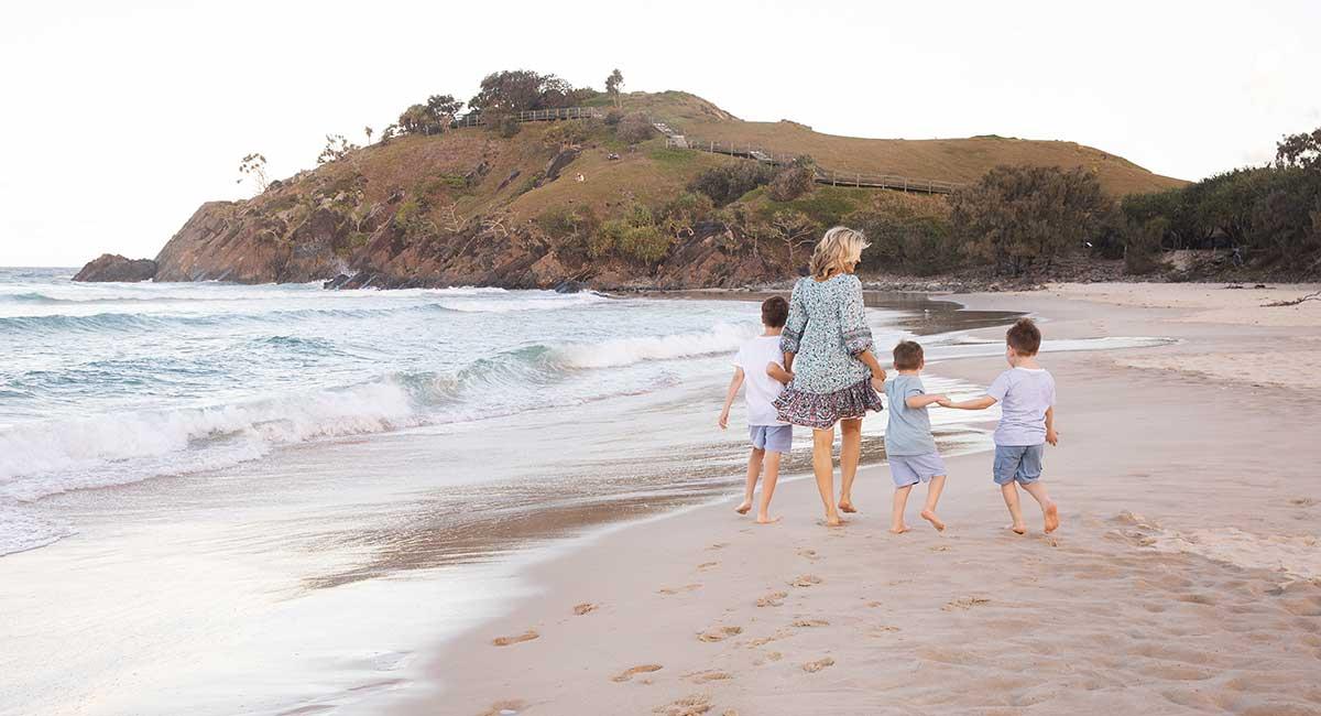 Walking on the beach teaching mindfulness to kids